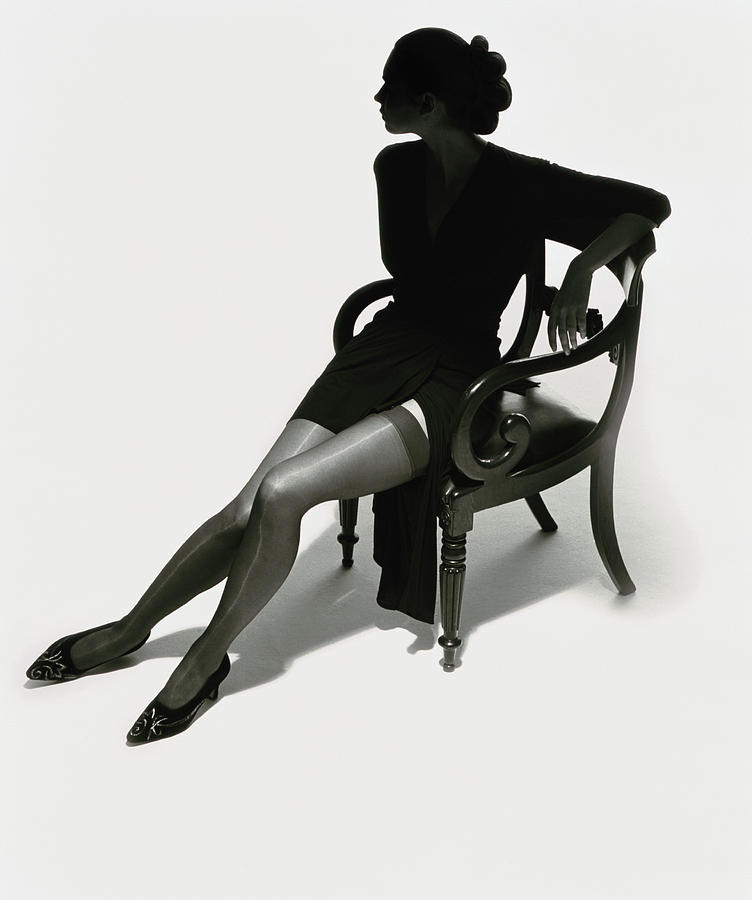 Silhouetted Woman On Chair Photograph by Tim Platt