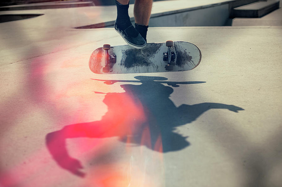 Shadow Photograph - Skateboarder Doing An Ollie by Devon Strong