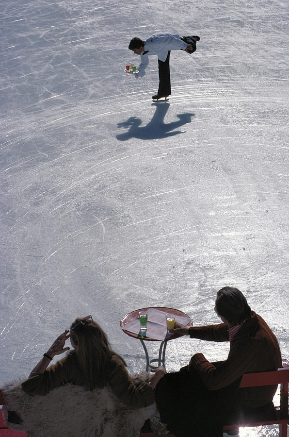 Skating Waiter Photograph by Slim Aarons