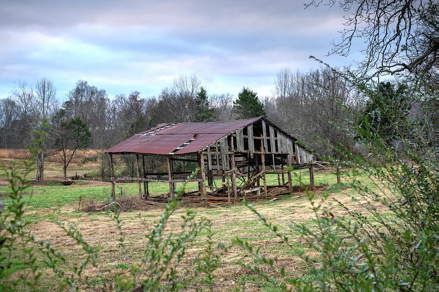 Skeleton Barn Under Darkening Sky by Douglas Barnett
