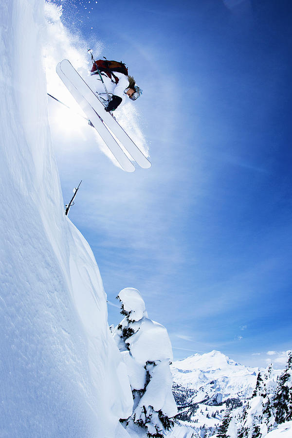 Skier Jumping On Snowy Slope Photograph by Jakob Helbig