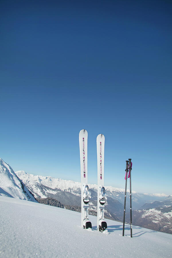 Skis And Ski Poles Stuck In The Snow Photograph by L.a. Novia