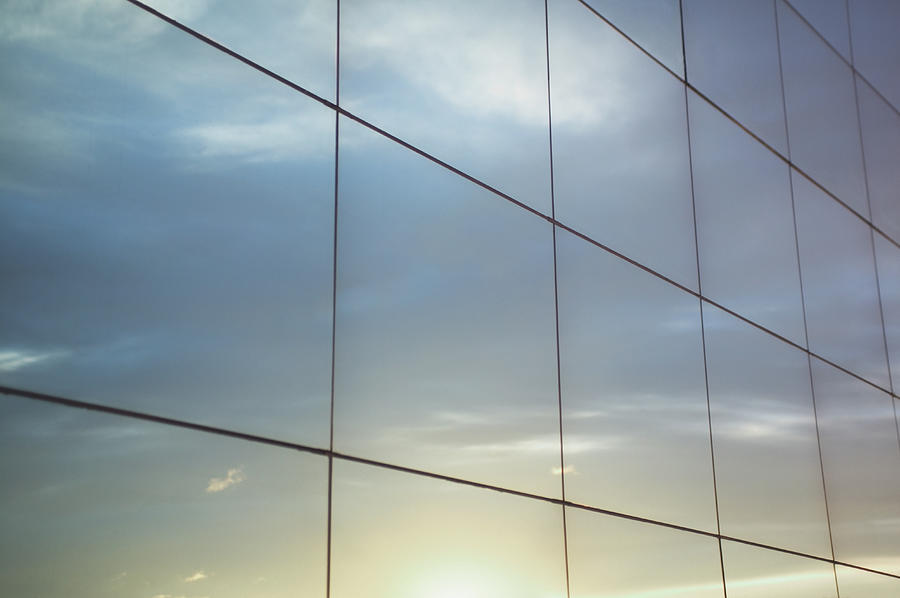 Sky Reflected In Office Windows Photograph by Martin Barraud