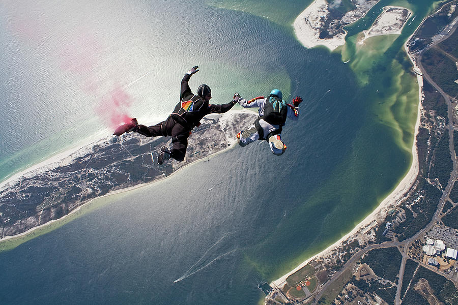 Skydivers In Freefall Over Nas Pensacola Photograph by Kevin Elvis King