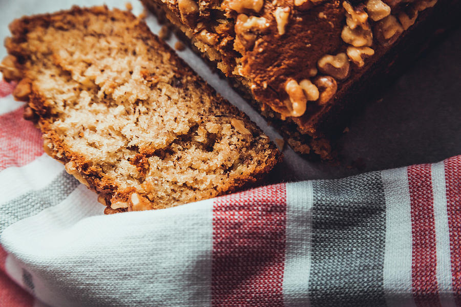 Sliced Banana Bread Resting On A Towel by Jeanette Fellows