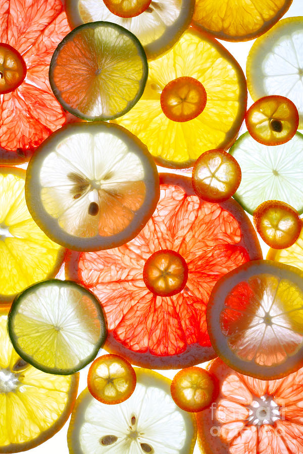 Color Photograph - Sliced Citrus Fruits Background by Gaak