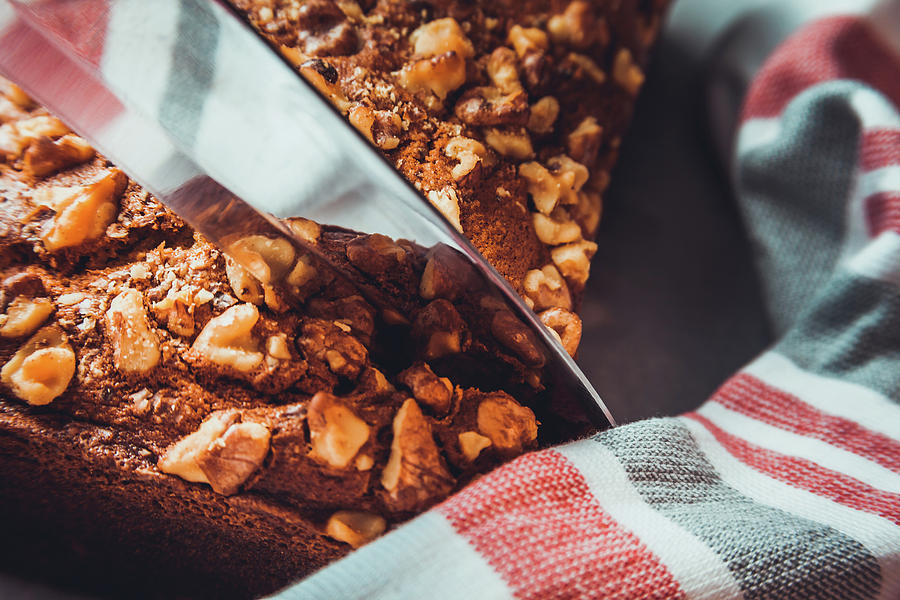Slicing Banana Bread by Jeanette Fellows