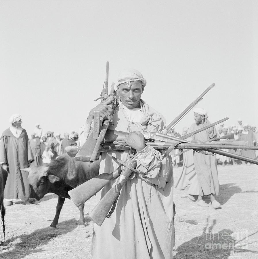 Smaala Tribesman Surrendering Rifles Photograph by Bettmann