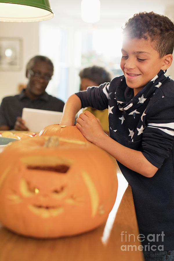Autumn Photograph - Smiling Boy Carving Halloween Pumpkins by Caia Image/science Photo Library