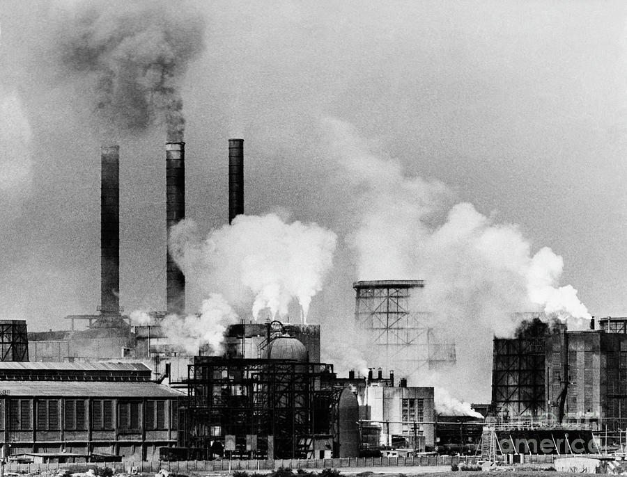 Smoke Rising From Factory Smokestacks Photograph by Bettmann