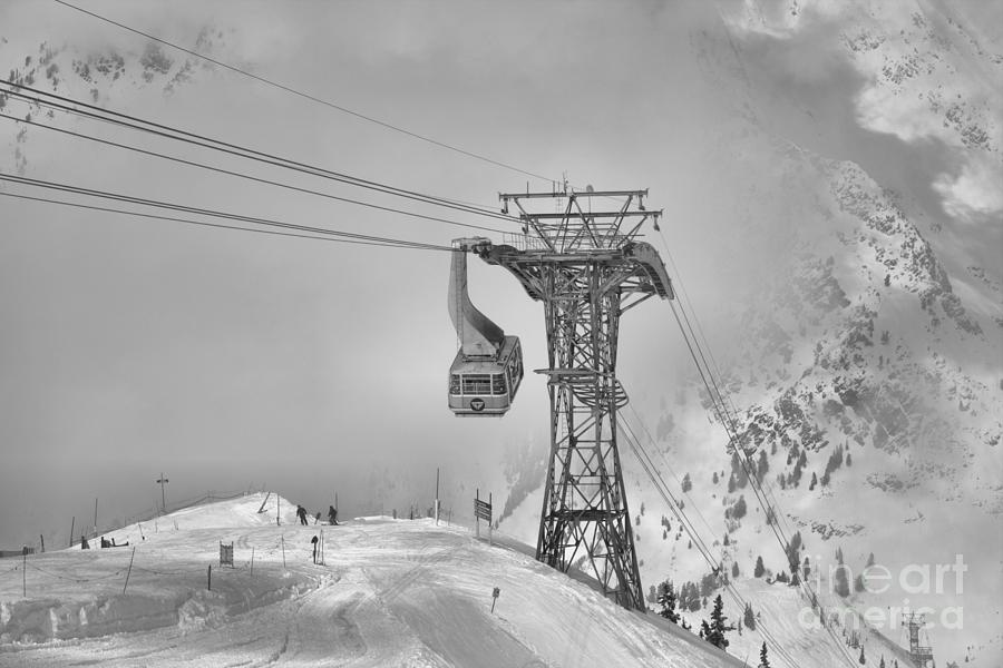Snowbird Blue Tram Car In The Clouds Black And White by Adam Jewell