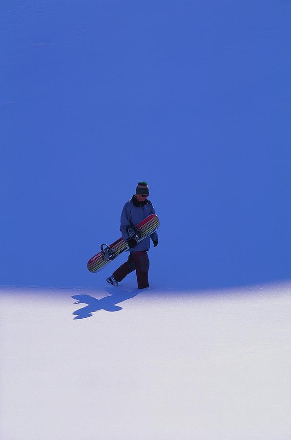 38f6de9bbb21 Snowboarder Carrying Board by Hans L Bonnevier