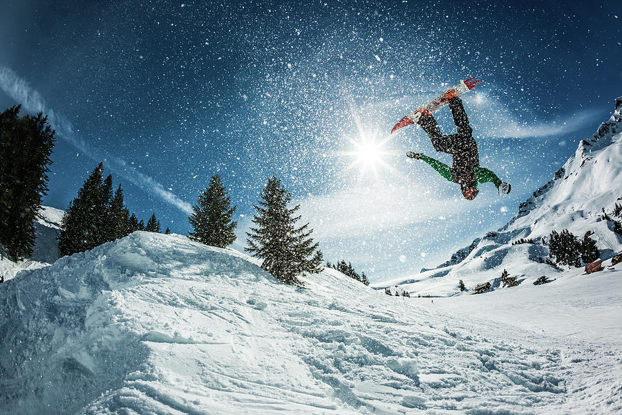 Snowboarder Doing A Backflip With Snow Photograph by © Francois Marclay