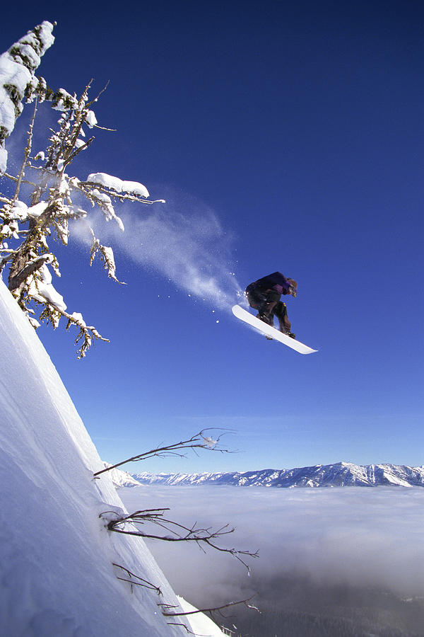 Snowboarder In Mid-air Photograph by Comstock Images