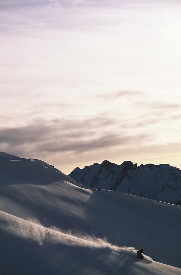 Snowboarder On Mountain Snowboarding Photograph by Rubberball/adam Clark