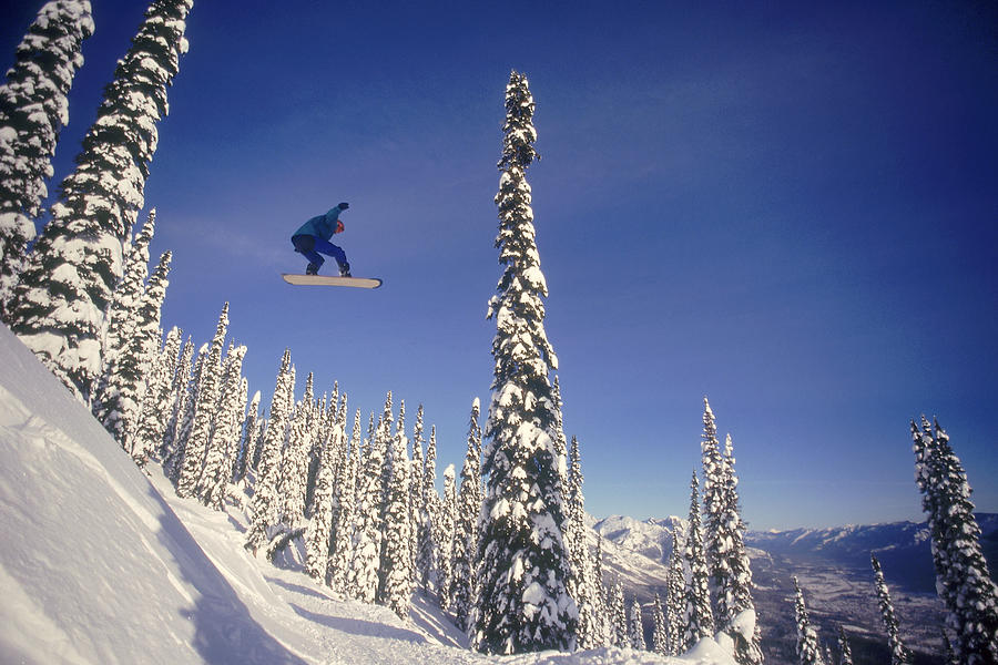 Snowboarding Jumping Through Air Photograph by Comstock