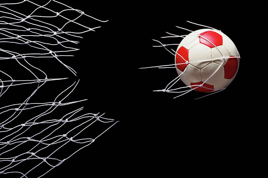 Soccer Ball Breaking Through Goal Net Photograph by Phillip Simpson Photographer
