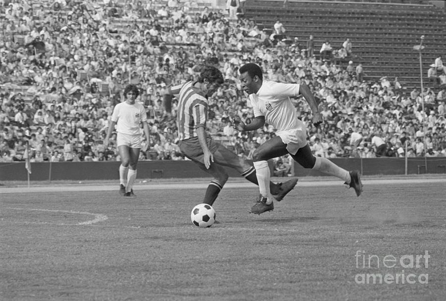 Soccer Star Pele Passing A Defensive Photograph by Bettmann