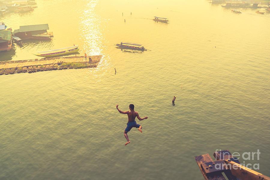 Strength Photograph - Soft Focus Man Jumping Over Fall River by Eakkaluktemwanich