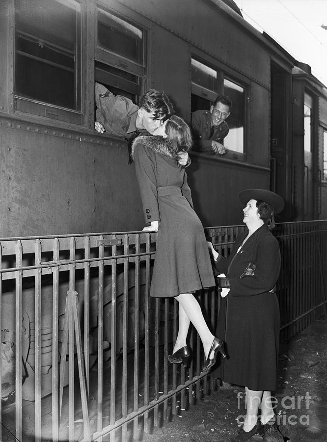 Soldier Kissing Girlfriend Goodbye Photograph by Bettmann