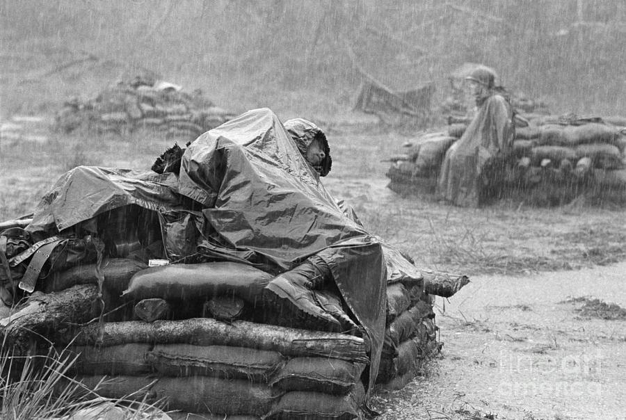 Soldier Sleeping During Downpour Photograph by Bettmann