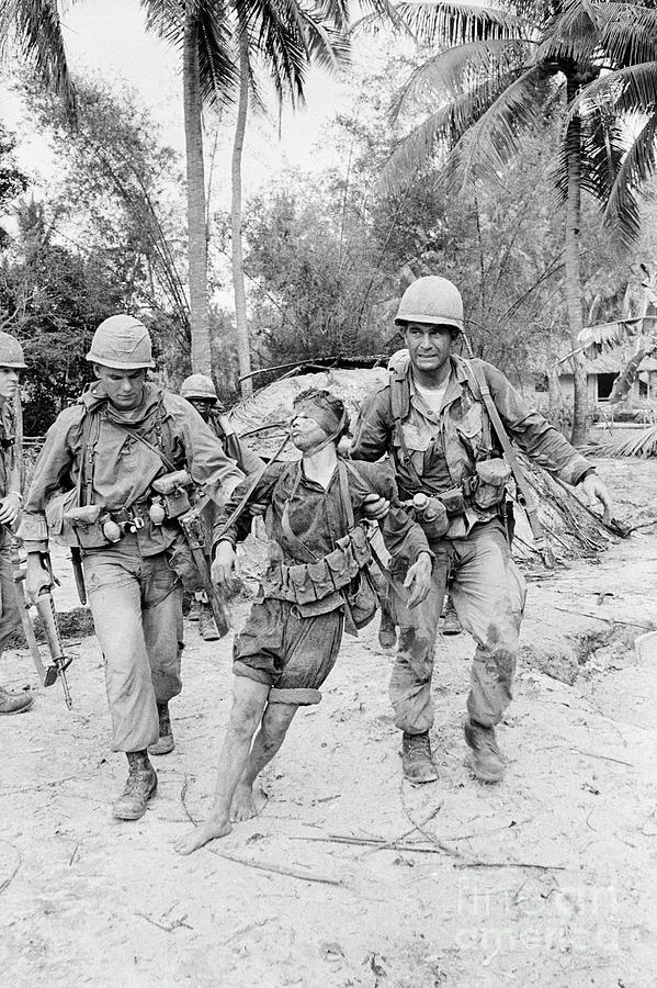 Soldiers Dragging Vietcong From Bunker Photograph by Bettmann