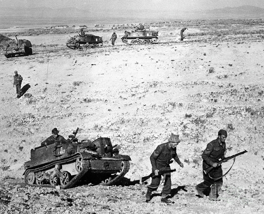 Soldiers Marching With Tank In Tunisia Photograph by Bettmann