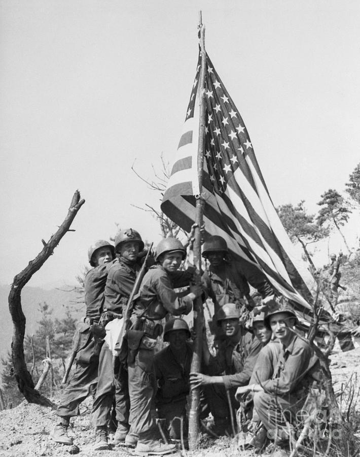 Soldiers Plant Flag On Korean Hill Photograph by Bettmann