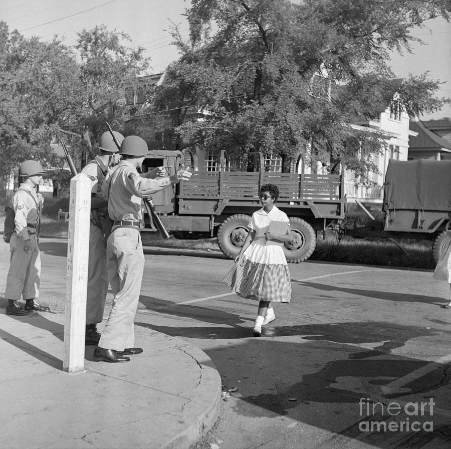 Soldiers Stopping African American Girl Photograph by Bettmann