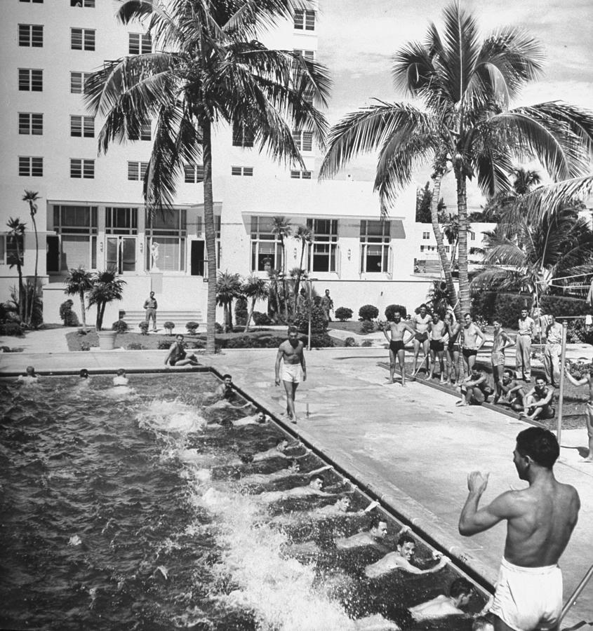 Soldiers Taking Swimming Lessons In The Photograph by William C. Shrout