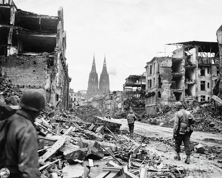 Soldiers Walking Through War Torn Photograph by Bettmann