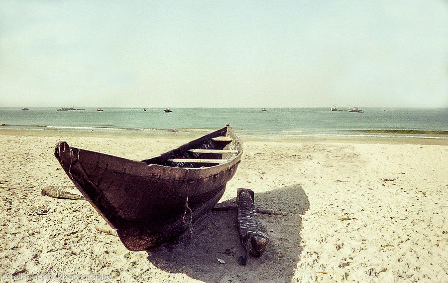 Solitary boat on a beach in Goa by Pete Hendley
