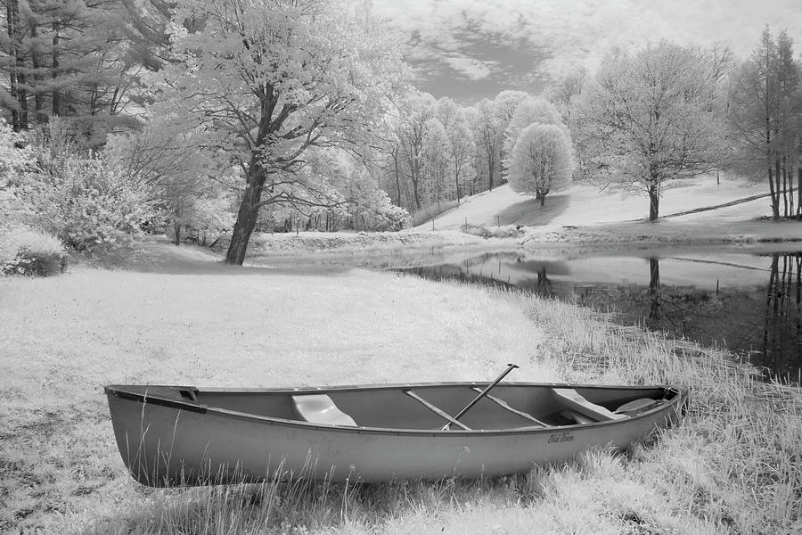 Winter Photograph - Solitary Canoe by Monte Nagler