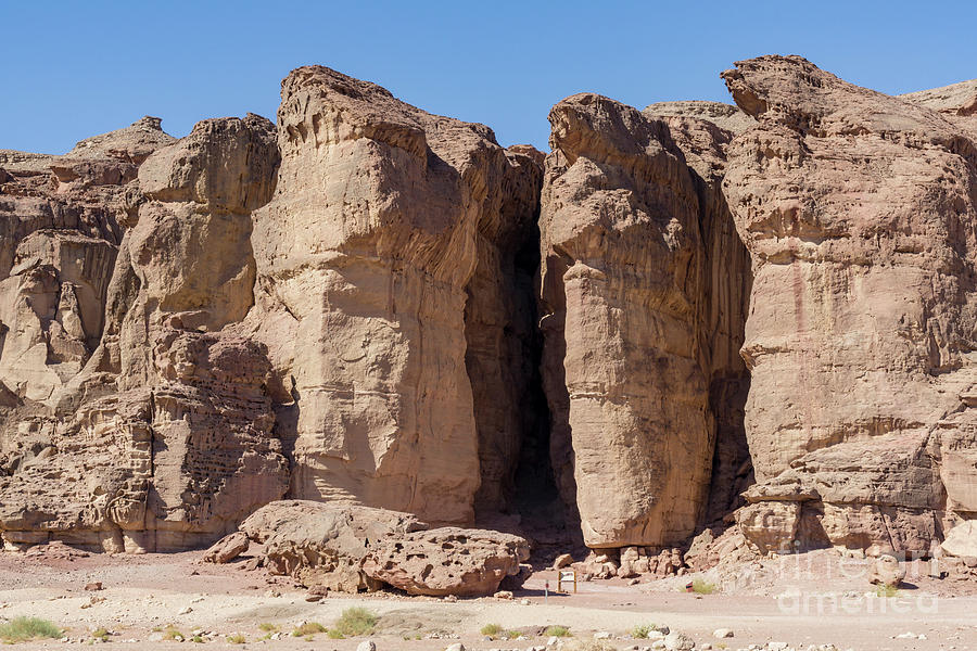 Solomon's Pillars in the Timna Valley in southern Israel. by William Kuta