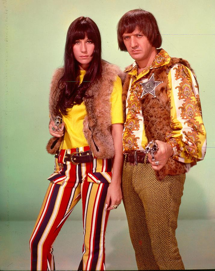 Sonny & Cher Take Aim Photograph by Michael Ochs Archives