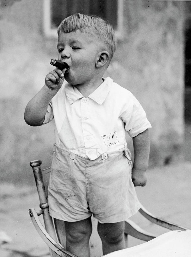 Sonny Smokes A Cigar Photograph by Fpg