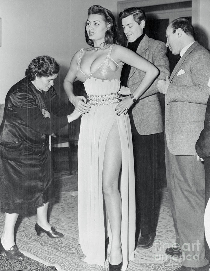 Sophia Loren Being Helped To Dress Photograph by Bettmann