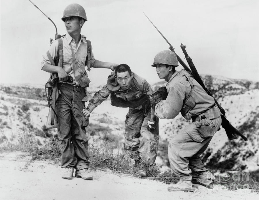 South Korean Soldiers Dragging North Photograph by Bettmann