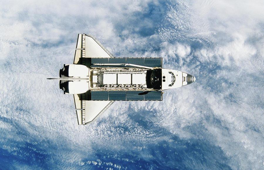 Space Shuttle Orbiting Earth, Satellite Photograph by Stocktrek