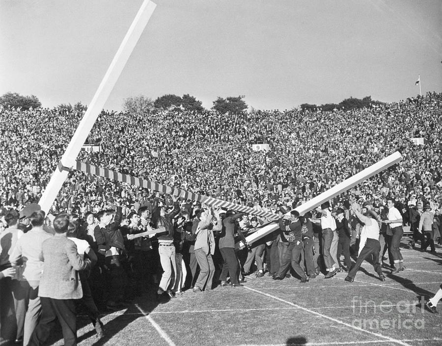 Spectators Tearing Down Goal Post Photograph by Bettmann