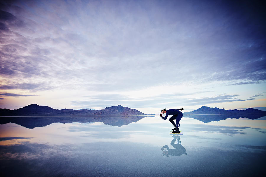Speed Skater Skating On Calm Lake At Photograph by Thomas Barwick