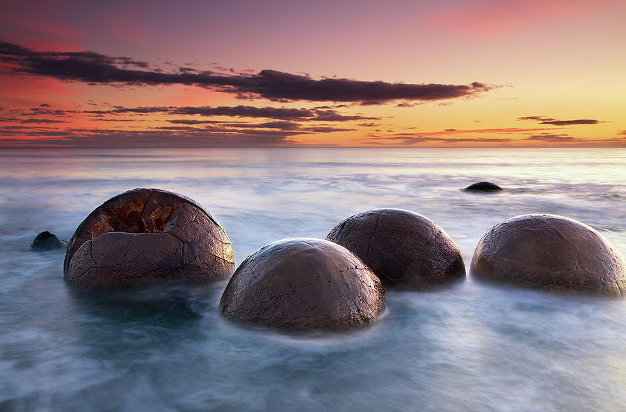 Spherical Boulders In The Sea At Sunrise Photograph by Christopher Chan