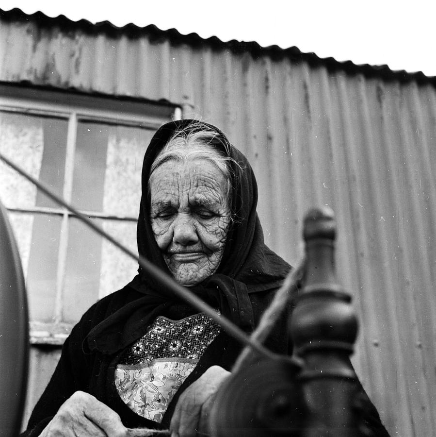 Spinning Lady Photograph by Thurston Hopkins