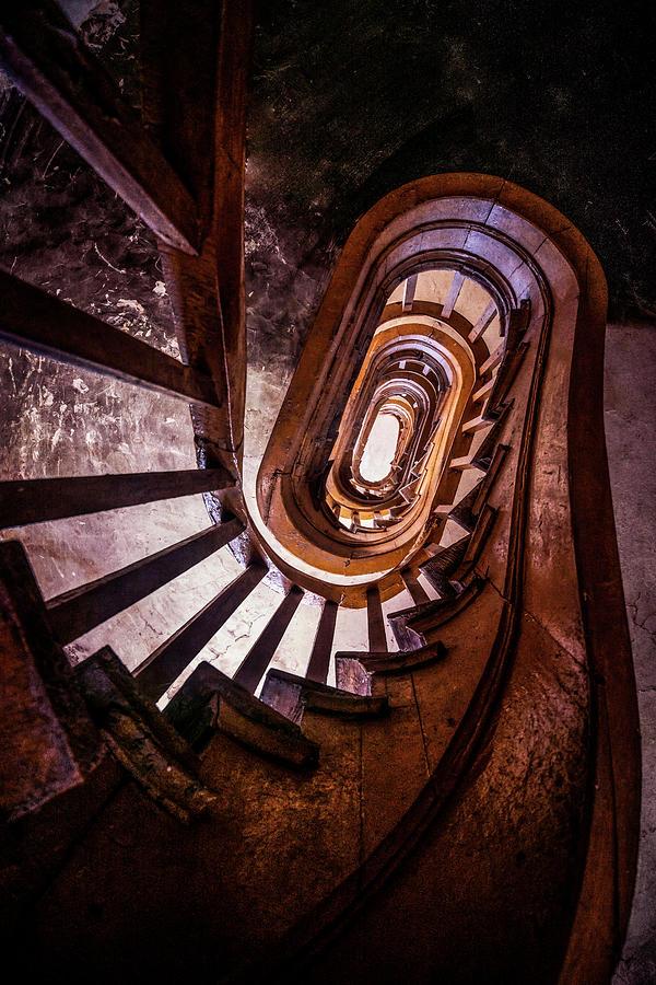 Spiral staircase in dark brown colors by Jaroslaw Blaminsky
