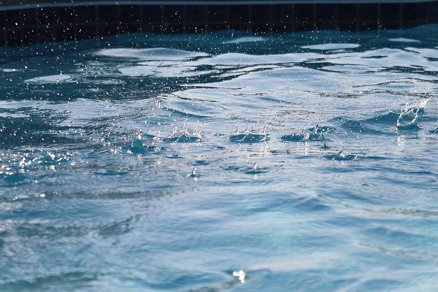 Splash Drops Across Water by TJ Fox