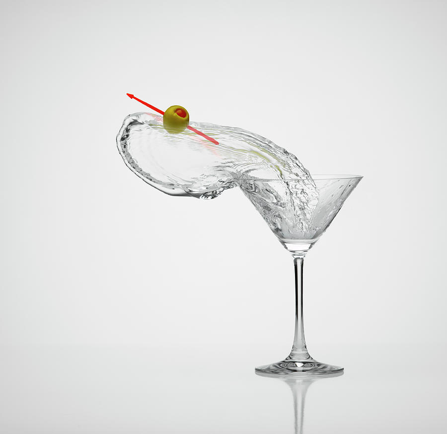 Splash Martini With Olive Photograph by Don Farrall
