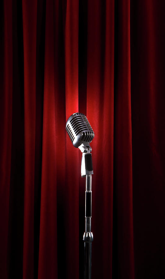 Spotlit Microphone Against Red Velvet Photograph by Tooga