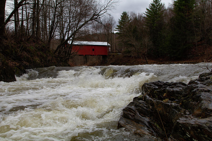 Spring runoff below Vermont covered bridge by Jeff Folger
