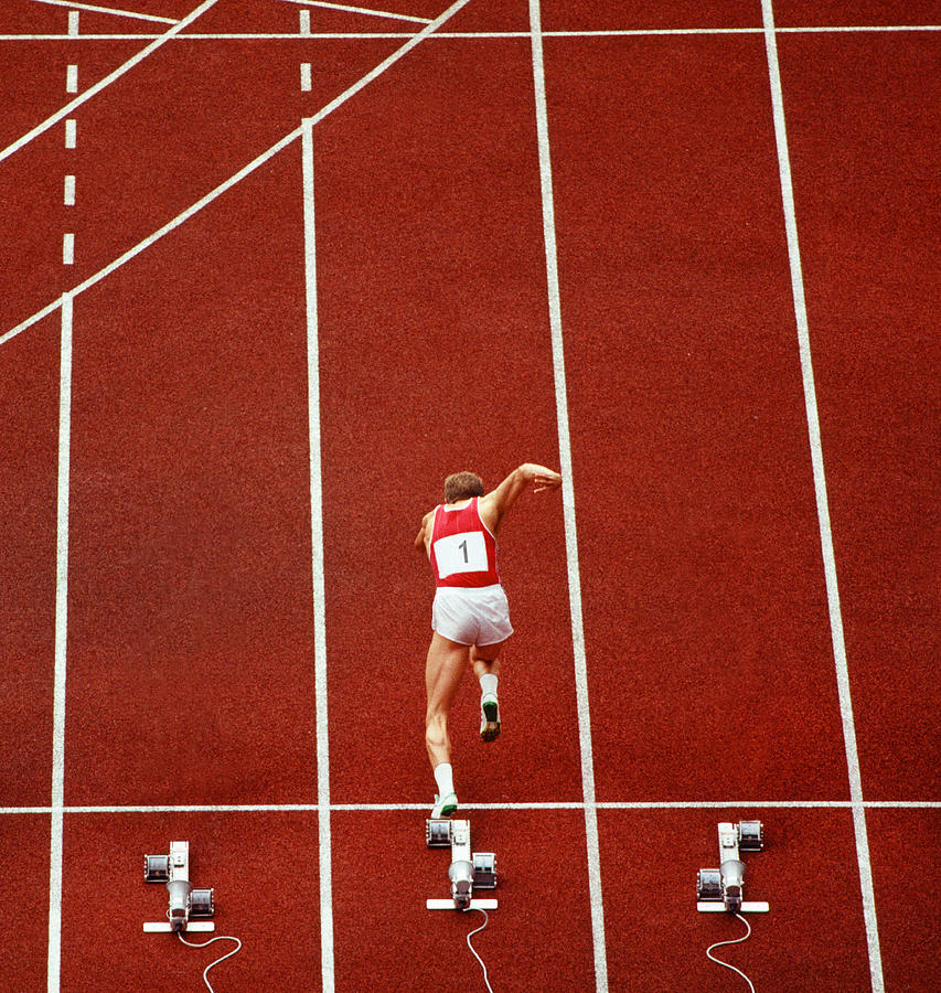 Sprint Runner Practising Starts On A Photograph by Grant Faint