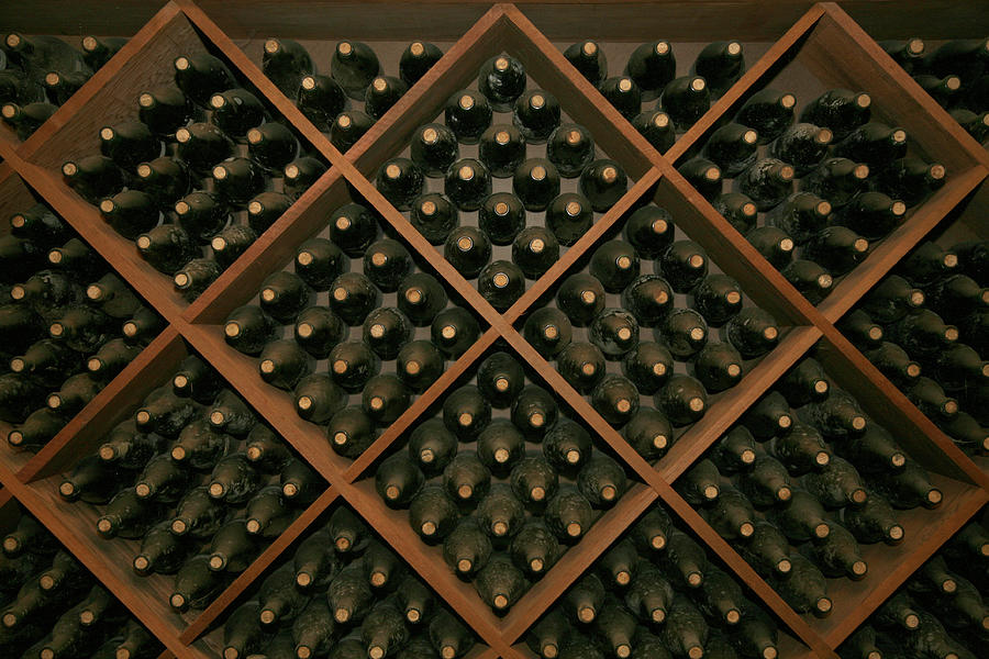 Stack Of Aging Wine Bottles Photograph by Terraxplorer